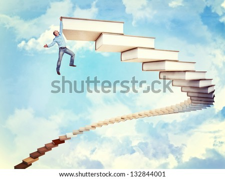 man hang to 3d books stair - stock photo