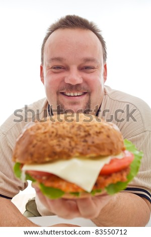Man happy with the size of his hamburger holding it happily - closeup, isolated - stock photo
