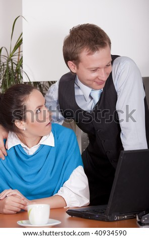 man harasses woman in the workplace - stock photo