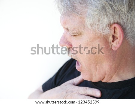 man has difficulty getting his breath - stock photo