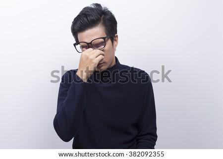 Man has eye pain - stock photo