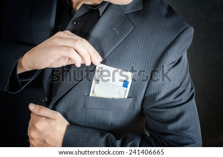 man have euros in envelope or pocket - stock photo