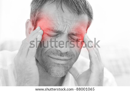 Man having a headache at home - stock photo