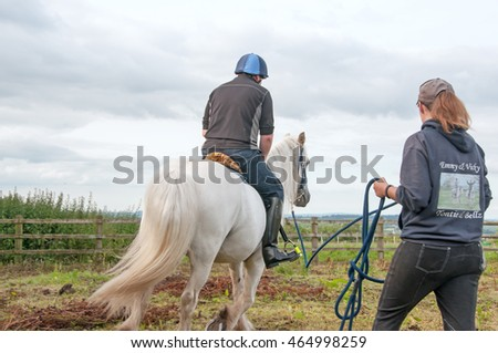 Man having a lunging lesson to improve his riding ability