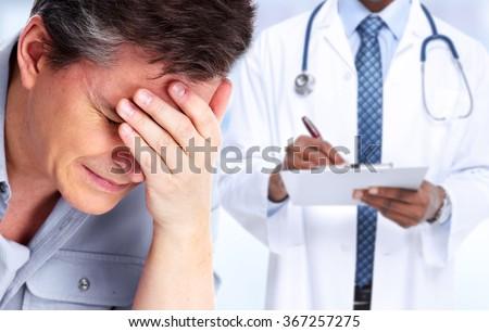 Man having a migraine headache. - stock photo