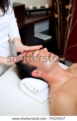 Man having a relaxing head massage - stock photo