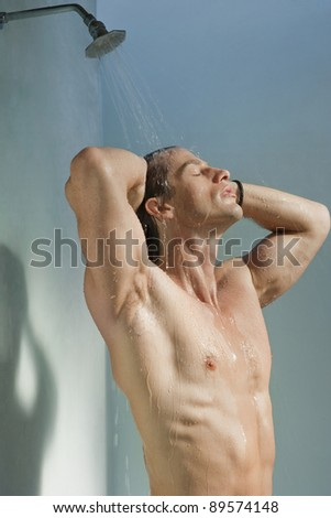Man having a shower. - stock photo