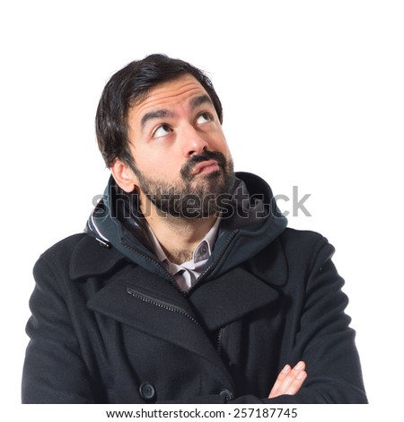 Man having doubts over white background