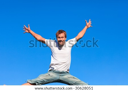 Man having fun by jumping in the air