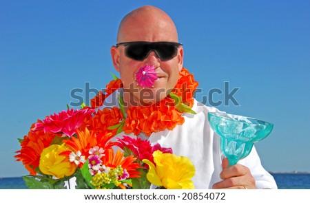 Man having fun while relaxing at seashore - stock photo