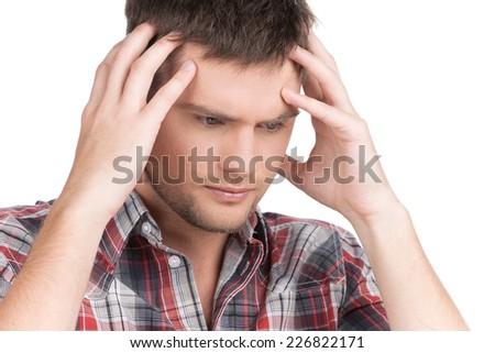 man having headache on white background. guy feeling stress and depression holding head - stock photo