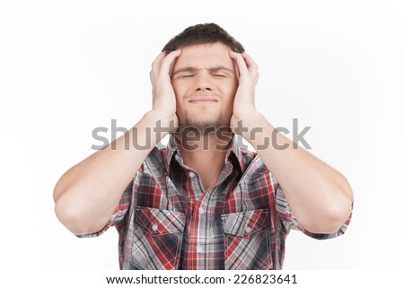 man having headache on white background. guy feeling stress and depression holding head with eyes closed - stock photo