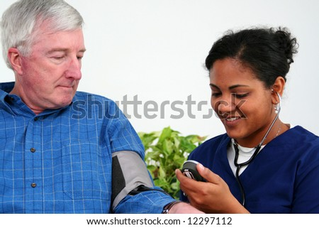 Man having his blood pressure checked by a nurse - stock photo