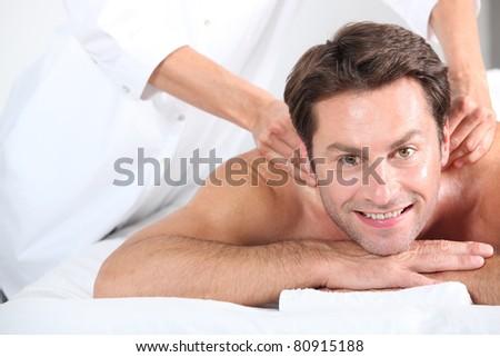 Man having massage - stock photo
