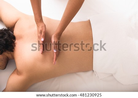 man having massage at spa