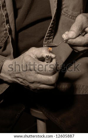 Man Heating Drugs on Spoon in preparation for Shooting up - stock photo