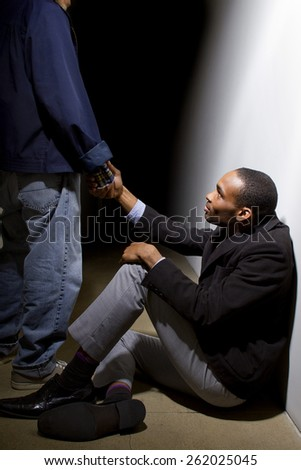 man helping a depressed fellow by offering a helping hand - stock photo