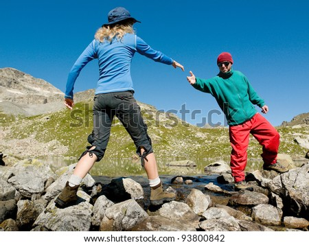 man helping hand to woman