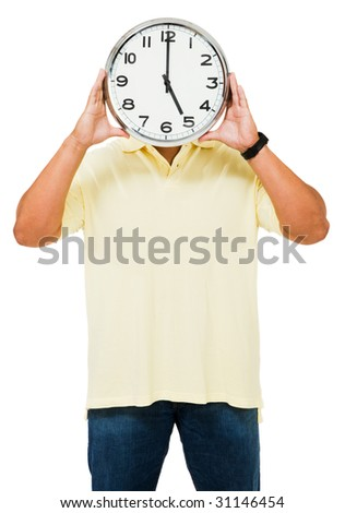 Man hiding his face with a clock isolated over white