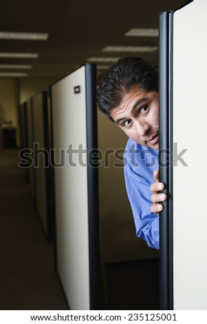 Man Hiding in Cubicle - stock photo