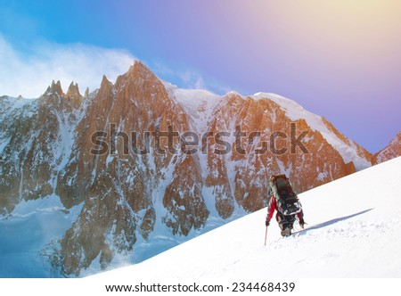 Man hiker trekking in high Himalaya Mountains in Nepal - stock photo