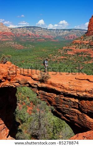 Man hiking at Devils Bridge in Sedona Arizona - stock photo