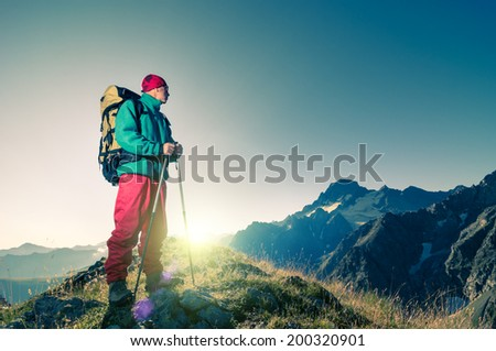 man hiking in a mountains instagram like toned filter - stock photo