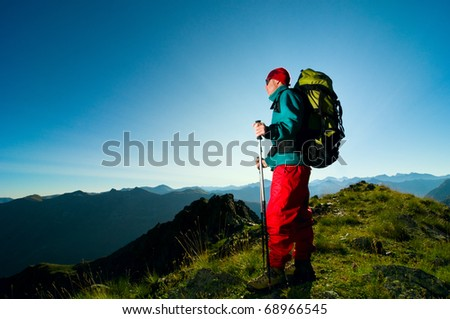 man hiking in mountain with backpack - stock photo