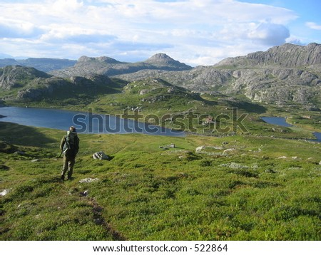 Man hiking in the mountains - stock photo