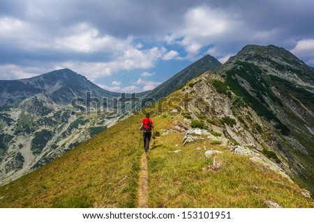 Man hiking in the mountains on a tourist track