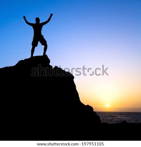 Man hiking success silhouette in mountains, sunset and ocean. Male hiker with arms outstretched on top of mountain looking at beautiful night sunset landscape.