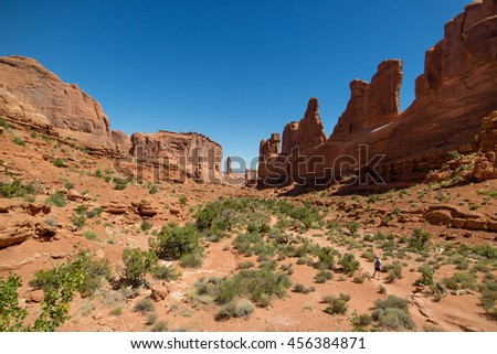 Man hiking through the Arches National Park, Moab, Utah, USA - stock photo