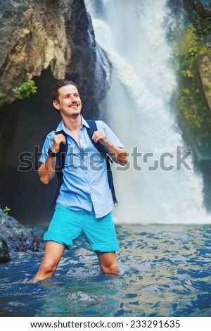 man hiking through the river in Bali, Indonesia