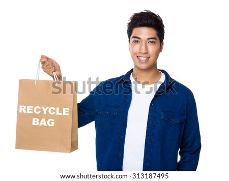 Man hold a shopping bag for showing phrase of recycle bag