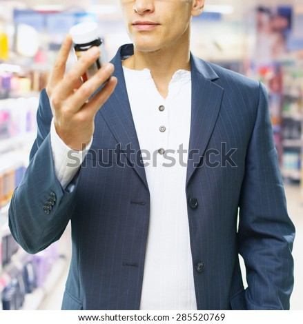 man hold and buy the pills - stock photo