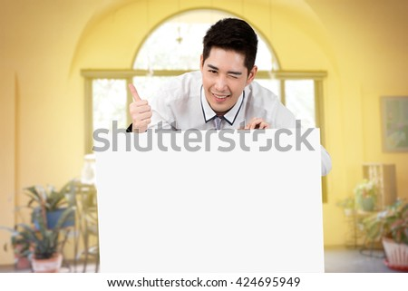 man hold blank white board smile and kidding in yellow room with vintage high light  tone