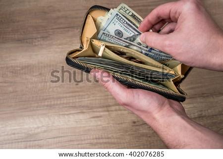 man hold full wallet - stock photo
