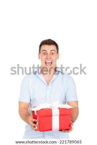 man hold gift box excited smile isolated over white background - stock photo