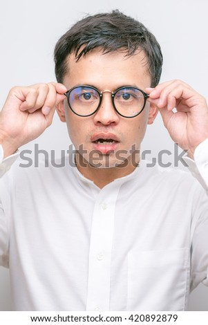 Man hold glasses white suit Nosebleeds patient close-up on white background - stock photo