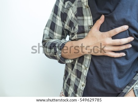 man hold his hand on breast look like heart attack