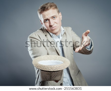 man hold in hand hat to donate helps   - stock photo
