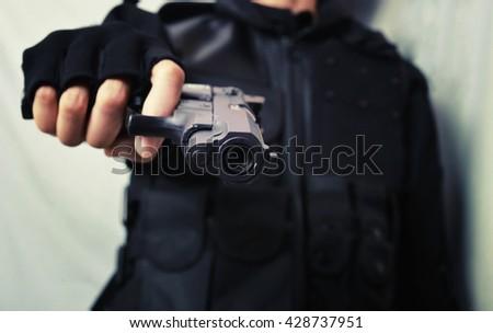 man hold short gun - stock photo