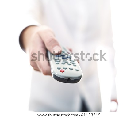 man hold tv remote control in his hand selective focus image - stock photo