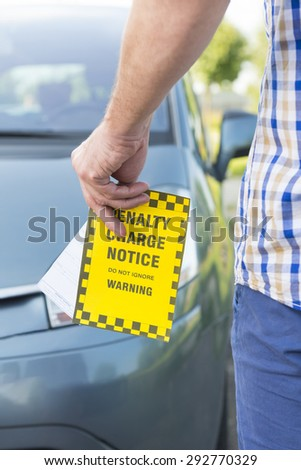 Man holdig parking ticket in his hand - stock photo