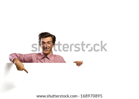man holding a banner in front of him, his hand point on the banner, smile - stock photo