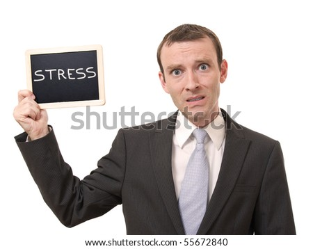 Man holding a blackboard with stress written - stock photo