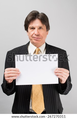 man holding a blank sheet of paper