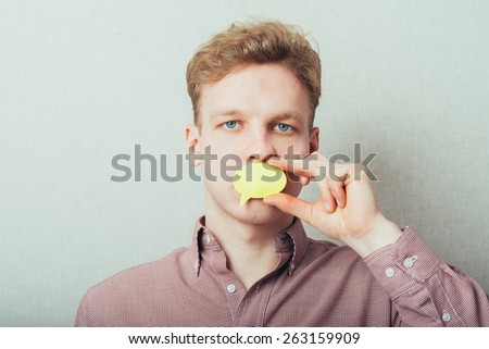 man holding a blank sticker for thought. - stock photo