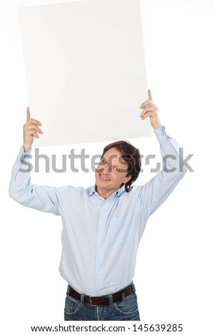 Man holding a blank white sign with copyspace for your text above his head isolated on white - stock photo