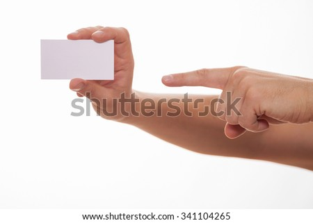 Man holding a business card and indicating it, white background
